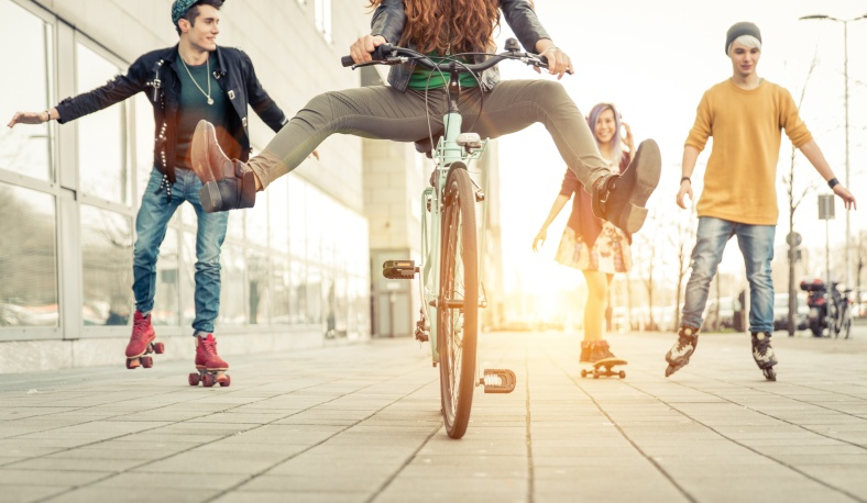 Group of active teenagers in town. four teens making recreationa